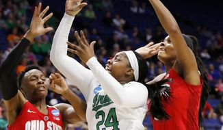 Notre Dame's Arike Ogunbowale (24) shoots between Ohio State's Shayla Cooper (32) and Tori McCoy during a regional semifinal in the women's NCAA college basketball tournament in Lexington, Ky., Friday, March 24, 2017. (AP Photo/James Crisp)