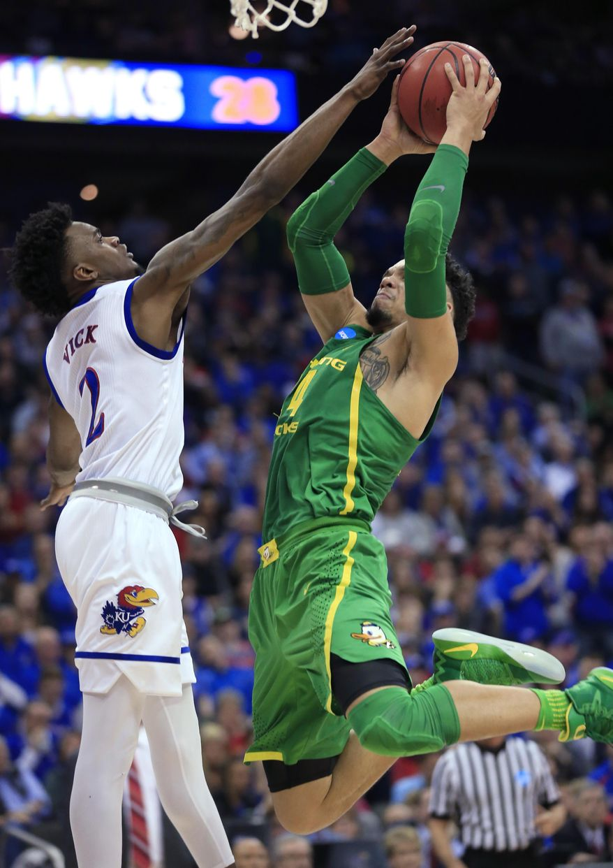 Oregon forward Dillon Brooks, right, shoots over Kansas guard Lagerald Vick during the first half of the Midwest Regional final of the NCAA men's college basketball tournament, Saturday, March 25, 2017, in Kansas City, Mo. (AP Photo/Orlin Wagner)