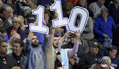 Fans hold a sign for 110 wins for the Connecticut women at the end a regional semifinal game between UConn and UCLA in the NCAA women's college basketball tournament, Saturday, March 25, 2017, in Bridgeport, Conn. (AP Photo/Jessica Hill)