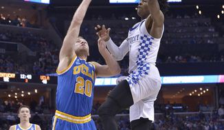 Kentucky guard De'Aaron Fox heads to the basket against UCLA guard Bryce Alford in the second half of an NCAA college basketball tournament South Regional semifinal game Friday, March 24, 2017, in Memphis, Tenn. (AP Photo/Brandon Dill)