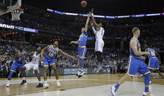 Kentucky guard De'Aaron Fox shoots against UCLA in the first half of an NCAA college basketball tournament South Regional semifinal game Friday, March 24, 2017, in Memphis, Tenn. (AP Photo/Mark Humphrey)