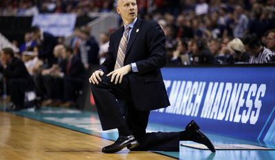 Xavier head coach Chris Mack kneels on the sideline during the second half of an NCAA Tournament college basketball regional final game against Gonzaga Saturday, March 25, 2017, in San Jose, Calif. (AP Photo/Tony Avelar)