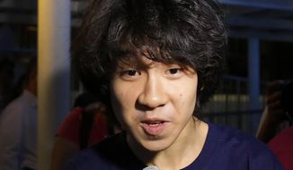 FILE - In this May 12, 2015, file photo, Singapore teen blogger Amos Yee speaks to a reporter while leaving the Subordinate Courts after being released on bail, in Singapore. Yee whose online posts blasting his government landed in him jail was granted asylum to remain in the United States, an immigration judge in Chicago ruled Friday, March 24, 2017. Yee has been detained by federal immigration authorities since December when he was taken into custody at Chicago's O'Hare International Airport. Attorneys said the 18-year-old could be released from a Wisconsin detention center as early as Monday. (AP Photo/Wong Maye-E, File)