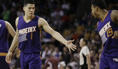 Phoenix Suns guard Devin Booker (1) is congratulated by guard Leandro Barbosa (19) in the fourth quarter of an NBA basketball game against the Boston Celtics, Friday, March 24, 2017, in Boston. Booker scored 70 points, but the Celtics won 130-120. Booker is just the sixth player in NBA history to score 70 or more points in a game. (AP Photo/Elise Amendola)