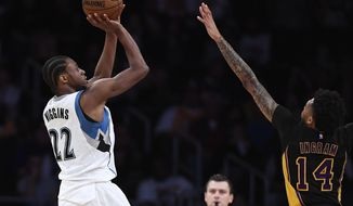 Minnesota Timberwolves forward Andrew Wiggins, left, shoots as Los Angeles Lakers forward Brandon Ingram defends during the first half of an NBA basketball game, Friday, March 24, 2017, in Los Angeles. (AP Photo/Mark J. Terrill)