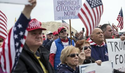 Supporters of President Donald Trump rally on the south end of the Seaside Heights boardwalk, Saturday, March 25, 2017, in Seaside Heights, N.J. (Doug Hood /The Asbury Park Press via AP)