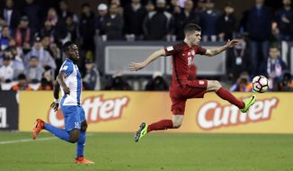 United States' Christian Pulisic, right, stops a pass next to a Honduras defender during the first half of a World Cup qualifying soccer match Friday, March 24, 2017, in San Jose, Calif. (AP Photo/Marcio Jose Sanchez)