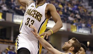 Indiana Pacers center Myles Turner (33) goes over Philadelphia 76ers guard Nik Stauskas (11) for a dunk a during the second half of an NBA basketball game in Indianapolis, Sunday, March 26, 2017. The Pacers defeated the 76ers 107-94. (AP Photo/Michael Conroy)