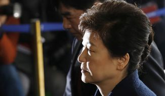 South Korea's ousted leader Park Geun-hye arrives at the prosecutor's office in Seoul, South Korea, in this March 21, 2017, file photo. Media reports say that South Korean prosecutors have decided to ask a court issue a warrant to arrest former President Park on corruption allegations. (Kim Hong-ji/Pool Photo via AP, File)