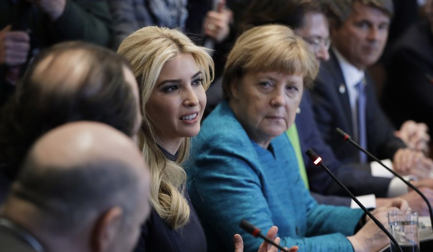 In this Friday, March 17, 2017, file photo, German Chancellor Angela Merkel listens as Ivanka Trump speaks during a meeting with President Donald Trump at the White House in Washington. Ivanka Trump is planning a trip to Germany to attend a summit on the economic empowerment of women, a senior administration official said Sunday, March 26. (AP Photo/Evan Vucci)