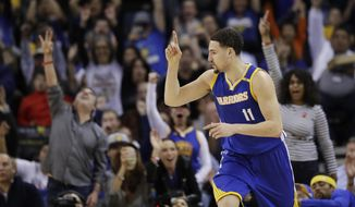 Golden State Warriors' Klay Thompson (11) celebrates after making a 3-point basket against the Memphis Grizzlies during the first half of an NBA basketball game Sunday, March 26, 2017, in Oakland, Calif. (AP Photo/Marcio Jose Sanchez)