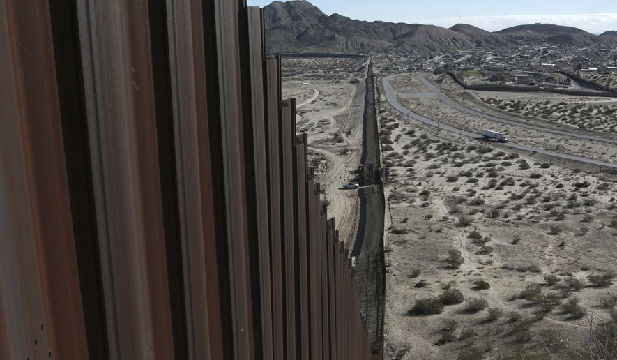 This Jan. 25, 2017, file photo shows a truck driving near the Mexico-U.S. border fence, on the Mexican side, separating the towns of Anapra, Mexico and Sunland Park, New Mexico. (AP Photo/Christian Torres, File)