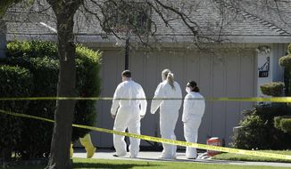 FILE - In this Thursday, March 23, 2017 file photo, investigators walk to the home where four people were found dead in Sacramento, Calif. A suspect is being held in San Francisco. The Sacramento County coroner's office on Sunday, March 26, 2017, confirmed the victims as 45-year-old Angelique Vasquez; her 14-year-old daughter, Mia Vasquez; her 11-year-old son, Alvin Vasquez; and 21-year-old Ashley Coleman. Police didn't immediately know what relationship Coleman had to the Vasquez family. (AP Photo/Rich Pedroncelli, File)