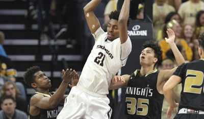 Woodcreek center Jordan Brown (21) pulls down a rebound against Bishop Montgomery defender Fletcher Tynen (35) during the first half of the boys' CIF Open Division high school basketball championship game in Sacramento, Calif., Saturday, March 25, 2017 (AP Photo/Steve Yeater)