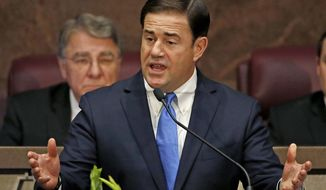 FILE - In this Monday, Jan. 9, 2017, file photo, Arizona Republican Gov. Doug Ducey gives his state of the state speech, opening the state legislature in Phoenix. Legislation signed by the Republican governor late Thursday, March 23, 2017, will cap the amount of jet fuel Phoenix is allowed to tax for each large carrier, costing the city about $2 million a year and benefiting American Airlines and Southwest Airlines in particular. (AP Photo/Ross D. Franklin, File)
