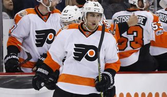 Philadelphia Flyers' Valtteri Filppula (51) returns to the bench after his goal during the second period of the team's NHL hockey game against the Pittsburgh Penguins in Pittsburgh, Sunday, March 26, 2017. (AP Photo/Gene J. Puskar)