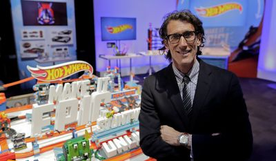 In this Saturday, Feb. 18, 2017, photo, Richard Dickson, president and chief operating officer of Mattel Inc., stands for a photo on Mattel's showroom floor at Toy Fair, in New York. Mattel, the maker of Barbie and Hot Wheels, which has live-action films based on those toys in the works, says it wants to find new ways to be on more screens in front of more kids. (AP Photo/Julie Jacobson)