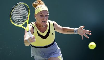 Svetlana Kuznetsova, of Russia, returns a shot from Taylor Townsend during a tennis match at the Miami Open, Sunday, March 26, 2017, in Key Biscayne, Fla. (AP Photo/Wilfredo Lee