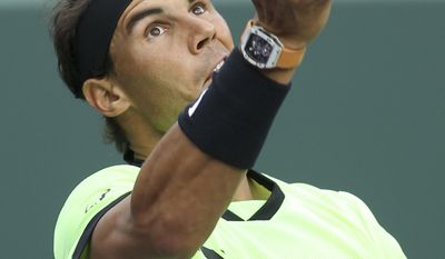 Rafael Nadal, of Spain, serves the ball to Philipp Kohlschreiber, of Germany, during the Miami Open tennis tournament, Sunday, March 26, 2017, in Key Biscayne, Fla. (AP Photo/Luis M. Alvarez)