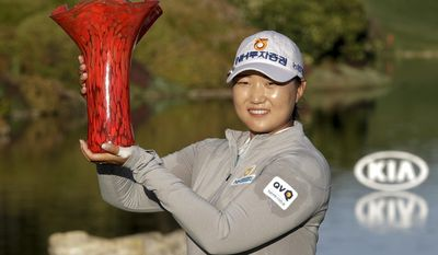 Mirim Lee, of South Korea, holds the trophy after winning the Kia Classic LPGA golf tournament Sunday, March 26, 2017, in Carlsbad, Calif. (AP Photo/Gregory Bull)