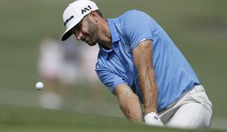 Dustin Johnson hits to the 16th green during semifinal play at the Dell Technologies Match Play golf tournament at Austin County Club, Sunday, March 26, 2017, in Austin, Texas. (AP Photo/Eric Gay)