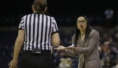 South Carolina head coach Dawn Staley, right, questions a call during the first half against Quinnipiac in a semifinal of the women's NCAA college basketball tournament Saturday, March 25, 2017, in Stockton, Calif.  (AP Photo/Rich Pedroncelli)