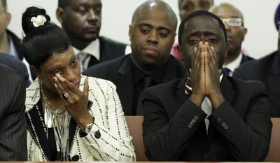 """FILE - In this June 13, 2012 file photo, Constance Malcolm and Frank Graham, parents of 18-year-old Ramarley Graham, weep during the arraignment of Officer Richard Haste, in Bronx Supreme Court, in the Bronx borough of New York. Haste, a white police officer who fatally shot an unarmed black teenager, resigned Sunday, March 26, 2017, from the New York Police Department to avoid being fired following a disciplinary trial. He was brought on departmental charges for demonstrating """"poor judgment"""" by not taking obvious steps to defuse a fatal standoff with Ramarley Graham. (AP Photo/Richard Drew, Pool, File)"""
