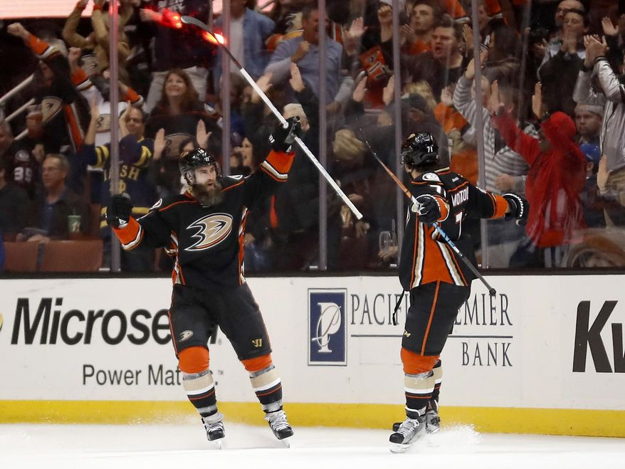 Anaheim Ducks right wing Patrick Eaves, left, celebrates with defenseman Brandon Montour after scoring a goal during the first period of the team's NHL hockey game against the New York Rangers, Sunday, March 26, 2017, in Anaheim, Calif. (AP Photo/Ryan Kang)