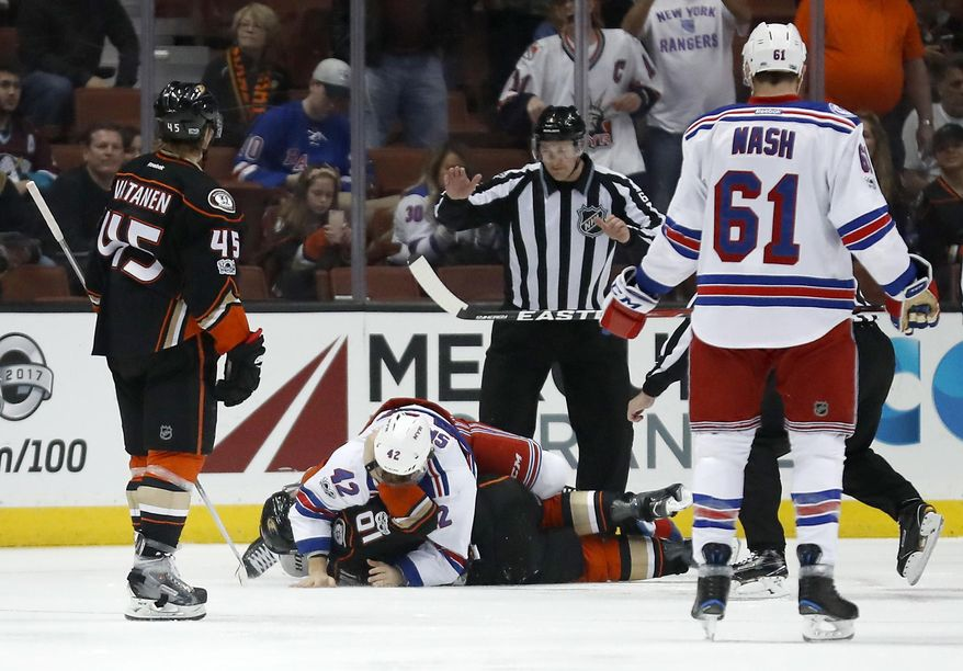 Anaheim Ducks right wing Corey Perry, bottom, and New York Rangers defenseman Brendan Smith, top, fight during the first period of an NHL hockey game, Sunday, March 26, 2017, in Anaheim, Calif. (AP Photo/Ryan Kang)