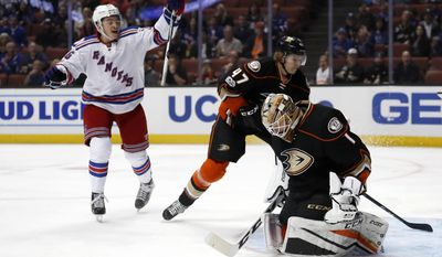 New York Rangers left wing Jimmy Vesey, left, reacts as Anaheim Ducks defenseman Hampus Lindholm, center, of Sweden, and goalie Jonathan Bernier, right, watch the puck go in the net on a goal by Rangers' Rick Nash during the first period of an NHL hockey game, Sunday, March 26, 2017, in Anaheim, Calif. (AP Photo/Ryan Kang)