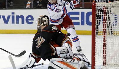 New York Rangers center Derek Stepan, top, scores a goal over Anaheim Ducks goalie Jonathan Bernier during the first period of an NHL hockey game, Sunday, March 26, 2017, in Anaheim, Calif. (AP Photo/Ryan Kang)