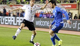 Germany's Jonas Nestor, left, and Azerbaijan's Afran Ismayilov challenge for the ball during their World Cup Group C qualifying match at the Tofig Bahramov Stadium in Baku, Azerbaijan, Sunday March 26, 2016. (AP Photo/Aziz Karimov)