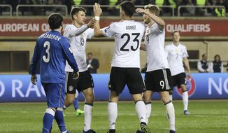 From left, Germany's Thomas Muller, Mario Gomes and Andre Schurrle celebrate their third goal against Azerbaijan during their World Cup Group C qualifying match at the Tofig Bahramov Stadium in Baku, Azerbaijan, Sunday March 26, 2016. (AP Photo/Aziz Karimov)