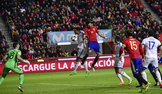 Spain's Diego Costa, center right, heads the ball to score during a 2018 World Cup Group G qualifying soccer match between Spain and Israel, at El Molinon Stadium, in Gijon, northern Spain, Friday, March 24, 2017. (AP Photo/Alvaro Barrientos)