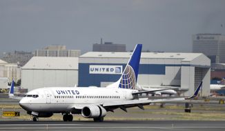 In this Sept. 8, 2015, file photo, a United Airlines passenger plane lands at Newark Liberty International Airport in Newark, N.J. United said on Monday, March 27, 2017, that regular-paying fliers are welcome to wear leggings aboard its flights, even though two teenage girls were barred by a gate agent from boarding a flight from Denver to Minneapolis Sunday because of their attire. (AP Photo/Mel Evans, File)