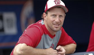 Washington Nationals starting pitcher Max Scherzer (31) watches batting practice before a spring training baseball game against the New York Mets Monday, March 27, 2017, in Port St. Lucie, Fla. (AP Photo/John Bazemore)