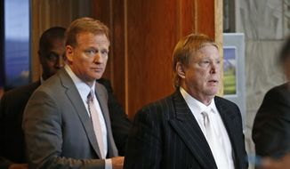 Oakland Raiders owner Mark Davis, right, emerges from the NFL football annual meetings with NFL Commissioner Roger Goodell, left, after owners approved the move of the Raiders to Las Vegas, Monday, March 27, 2017, in Phoenix. (AP Photo/Ross D. Franklin)