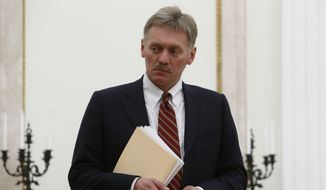 Kremlin spokesman Dmitry Peskov attends a meeting between Russian President Vladimir Putin and Serbian Prime Minister Aleksandar Vucic at the Kremlin in Moscow, Russia, Monday March 27, 2017. (Sergei Karpukhin/Pool photo via AP)