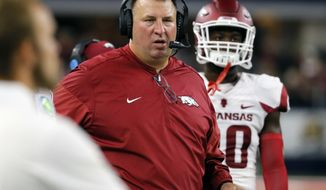 FILE - In this Sept. 24, 2016, file photo, Arkansas coach Bret Bielema watches from the sideline during the first half of the team's NCAA college football game against Texas A&M, in Arlington, Texas. After ending last season with two straight second-half collapses to finish 7-6, Arkansas returns to the field when it begins spring practices on Tuesday, March 28, 2017. (AP Photo/Tony Gutierrez, File)