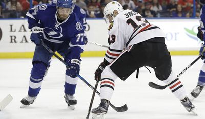 Chicago Blackhawks left wing Tomas Jurco (13) shoots past Tampa Bay Lightning defenseman Victor Hedman (77) and goalie Andrei Vasilevskiy (not shown) for a goal during the first period of an NHL hockey game, Monday, March 27, 2017, in Tampa, Fla. (AP Photo/Chris O'Meara)