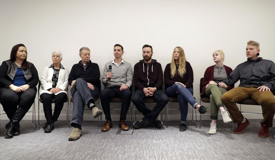 Family members of U.S. tourist Kurt Cochran, who was killed in Wednesday's London attack, and his wife Melissa, who was injured, attend a press conference at New Scotland Yard, the headquarters of London's Metropolitan Police force, in London, Monday, March 27, 2017. British police say that two people remain in custody following last week's attack in London as messaging services face criticism for encrypted networks that allow attackers to communicate in secret.(AP Photo/Matt Dunham)