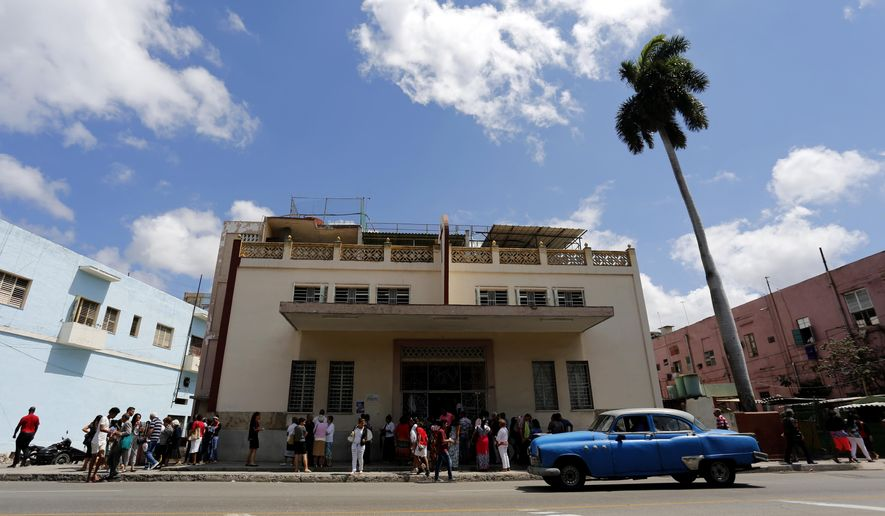 In this March 19, 2017 photo, people leave the Fuente De Vida Church after Sunday worship in Havana, Cuba. While the government now recognizes freedom of religion, it doesn't grant the right to build churches or other new religious structures. It has demolished a handful of churches in recent years, but allowed their members to continue meeting in makeshift home sanctuaries. (AP Photo/Desmond Boylan) **FILE**