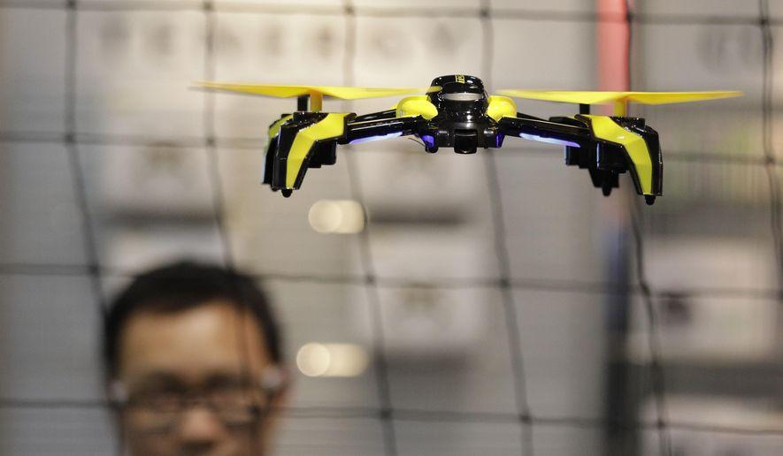 In this Jan. 5, 2017, file photo, a drone flies in Las Vegas. (AP Photo/John Locher, File) **FILE**