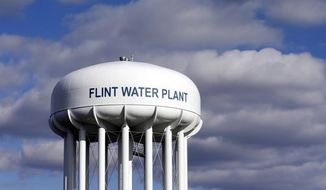 In this March 21, 2016 file photo, the Flint Water Plant water tower is seen in Flint, Mich. The U.S. Environmental Protection Agency said on March 27, 2017, that a $100 million grant to address drinking water issues in the city was approved after a formal application from Michigan state officials. (AP Photo/Carlos Osorio, File)