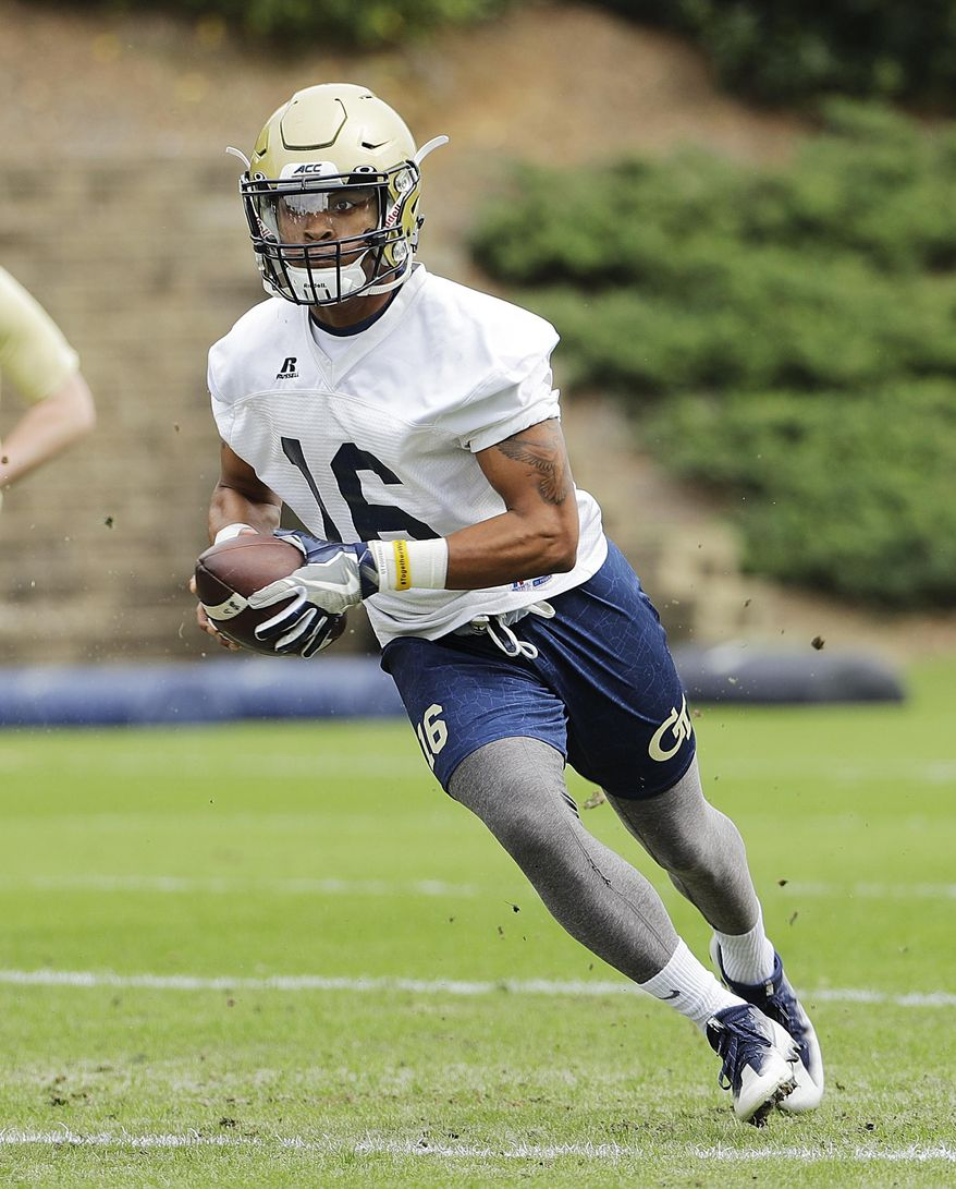 Georgia Tech quarterback TaQuon Marshall runs a play during an NCAA college football practice in Atlanta, Monday, March 27, 2017. Coming off a nine-win season, Georgia Tech begins spring football practice Monday with all eyes on the quarterback position after the departure of three-year starter Justin Thomas. (AP Photo/David Goldman)