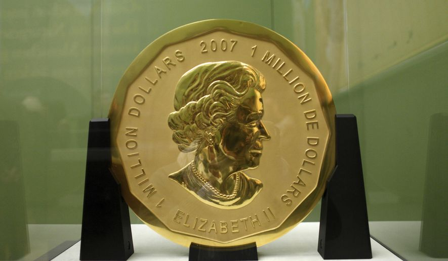 """The Dec. 12, 2010, file photo shows the gold coin """"Big Maple Leaf"""" in the Bode Museum in Berlin. The 100-kilogram (220 pound) gold coin disappeared from the museum. (Marcel Mettelsiefen/dpa via AP)"""