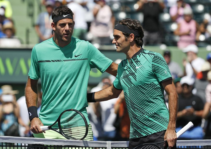 Roger Federer, of Switzerland, right, and Juan Martin del Potro, of Argentina, take a photo together before the start of a tennis match at the Miami Open, Monday, March 27, 2017 in Key Biscayne, Fla. (AP Photo/Wilfredo Lee)