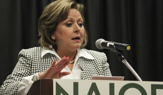 Gov. Susana Martinez speaks about the recent legislative session to a group of business leaders and real estate developers during a luncheon in Albuquerque, N.M., on Monday, March 27, 2017. The two-term Republican governor warned that New Mexico is facing a dire fiscal situation and employee furloughs are possible. (AP Photo/Susan Montoya Bryan)