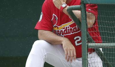 St. Louis Cardinals manager Mike Matheny  looks out from the dugout during the Cardinals' 5-3 win over the Miami Marlins in a spring training baseball game Thursday, March 23, 2017, in Jupiter, Fla. (AP Photo/John Bazemore)
