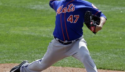 New York Mets' Hansel Robles pitches against the Atlanta Braves in the seventh inning of a spring training baseball game, Saturday, March 25, 2017, in Kissimmee, Fla. (AP Photo/John Raoux)